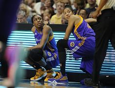 Nneka Ogwumike and Candace Parker wait to be substituted into the game. AP Photo/Jessica Hill.