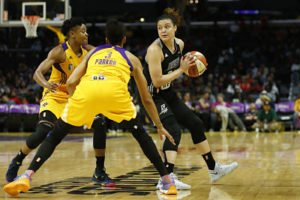 Kayla McBride debates her options against the Sparks defense. Photo by Maria Noble, WomensHoopsWorld.