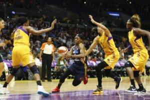 Erica Wheeler drives through the Sparks offense. Photo by Maria Noble/WomensHoops World.