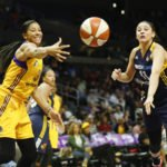 Candace Parker gets the ball by Natalie Achonwa. Photo by Maria Noble/WomensHoopsWorld.