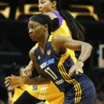 Erica Wheeler and Candace Parker both spy the ball at the same time. Photo by Maria Noble/WomensHoopsWorld.
