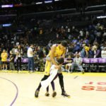 Candace Parker is greeted by eight-year-old daughter Lailaa after the game. Photo by Maria Noble/WomensHoopsWorld.