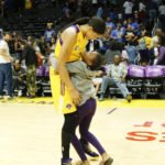 Candace Parker and daughter Lailaa have their customary post-game words. Photo by Maria Noble/WomensHoopsWorld.