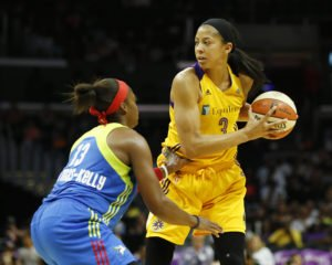 Candace Parker looks for an outlet as Karima Christmas-Kelly defends. Photo by Maria Noble/WomensHoopsWorld.