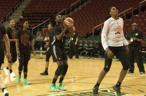 Elizabeth Williams shoots as Jonquel Jones prepares to rebound. Photo by Jamie Mitchell/TGTVsports1.