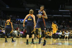 Jonquel Jones manages to have fun while averaging a double-double this season. Photo by Maria Noble/WomensHoopsWorld.