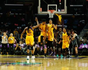 The Sparks celebrate their lead late in the game. Photo by Maria Noble/WomensHoopsWorld.