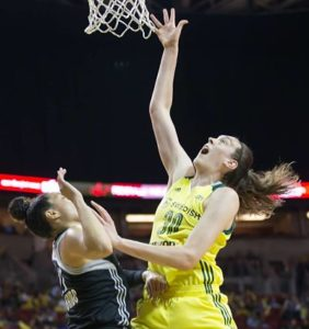 Breanna Stewart scores over Dearica Hamby. Photo by Neil Enns/Storm Photos.
