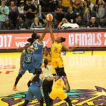 Sylvia Fowles and Nneka Ogwumike jump for the ball to start the game. Photo by Benita West/TGSportsTV1.