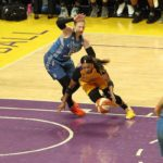 Odyssey Sims tries to get by Lindsay Whalen. Photo by Benita West/TGSportsTV1.