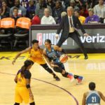 Maya Moore is guarded by defensive player of the year Alana Beard. Photo by Benita West/TGSportsTV1.