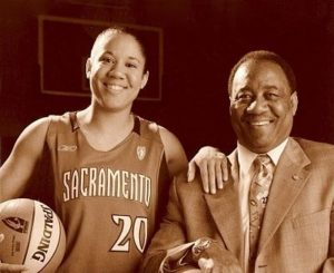 Kara Lawson and her father Bill Lawson in 2003. Photo by Robert Beck/NBAE via Getty Images.
