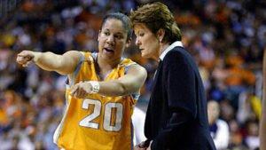 Kara Lawson and Pat Summitt talk strategy during a game. Photo by Elsa/NBAE via Getty Images.