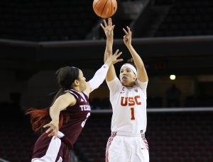Jordan Adams shoots over the defense. Photo by Maria Noble/WomensHoopsWorld.