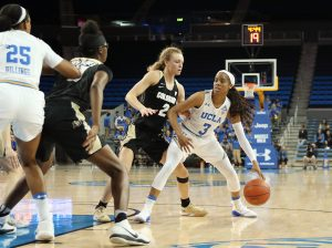 Jordin Canada sizes up the best passing option. Photo by Maria Noble/WomensHoopsWorld.