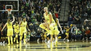 Lexi Bando celebrates after hitting an improbable three-point shot with 46 seconds remaining. Eric Evans Photography/Oregon Athletics.