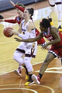 Robbi Ryan beats her defenders to the shot. Photo courtesy of Sun Devil Athletics.