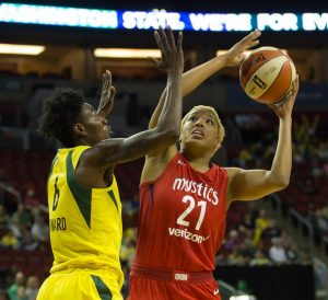 The contributions of fifth-year forward Natasha Howard, seen guarding Tianna Hawkins, have put her into the Storm's starting lineup. Neil Enns/Storm Photos.