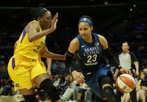 Maya Moore initiates the drive past Sparks forward Nneka Ogwumike. Maria Noble/WomensHoopsWorld.