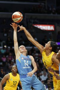 Candace Parker deflects Allie Quigley's shot. Photo by Maria Noble/WomensHoopsWorld.