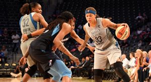 Seimone Augustus is double-teamed by the Dream defense. Photo courtesy of Minnesota Lynx.