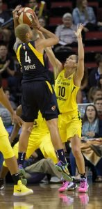 Candice Dupree elevates over Sue Bird to score. Neil Enns/Storm Photos.