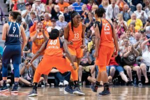 Shekinna Stricklen, Chiney Ogwumike and Alyssa Thomas exult after the win. Photo by Chris Poss.