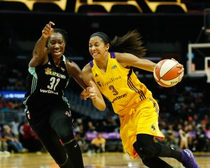 Tina Charles, left and Candace Parker play in a WNBA that is full of strong women who play physical basketball. Maria Noble/WomensHoopsWorld.