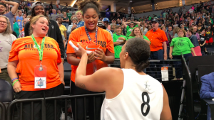 Liz Cambage gives Sophia Thomas one of her shoes after Saturday's All-Star game. Photo by Micah Friez.