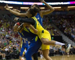 Allisha Gray, Alysha Clark and Azura' Stevens battle for a rebound. Neil Enns/Storm Photos.
