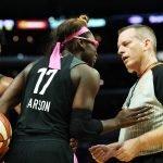 Essence Carson talks to referee Kurt Walker about a call. Maria Noble/WomensHoopsWorld.