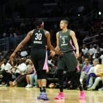Nneka Ogwumike and Candace Parker slap hands at mid-court. Maria Noble/WomensHoopsWorld.