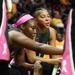Chelsea Gray and Candace Parker talk strategy at a timeout. Maria Noble/WomensHoopsWorld.