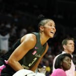 Maria Vadeeva and Candace Parker watch a shot fall from the bench. Maria Noble/WomensHoopsWorld.