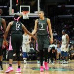 Chelsea Gray and Candace Parker slap hands. Maria Noble/WomensHoopsWorld.