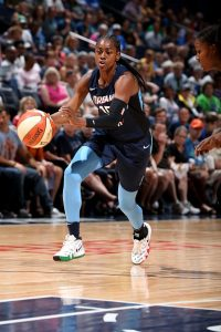 Tiffany Hayes brings the ball up court. She made six three-point shots for the Dream against the Lynx. Photo by David Sherman/NBAE via Getty Images.