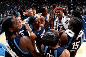 The Atlanta Dream celebrate their series tie-breaking win over the Minnesota Lynx. Photo by David Sherman/NBAE via Getty Images.