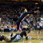Alysha Clark tries to recover the ball after a collision with Maya Moore, Lindsey Wasson/Seattle Storm.