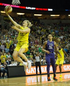 Sami Whitcomb takes the ball to the hoop as Brittney Griner watches in dismay. Neil Enns/Storm Photos.