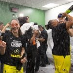 Sue Bird and the Storm celebrate after the win. Neil Enns/Storm Photos.