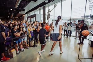 Candace Parker and daughter Lailaa greet the crowd that has showed up for the unveiling of her new shoe. Photo courtesy of Adidas.