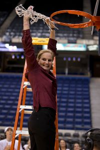 Fordham coach Stephanie Gaitley cuts down the next after her team's A-10 Tournament win in 2014. Photo courtesy of Fordham Athletics.