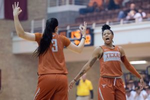 """Danni Williams, left, and Sug Sutton celebrate a three-point shot at the """"Texas Tipoff"""" this week. Photo courtesy of Texas Athletics."""
