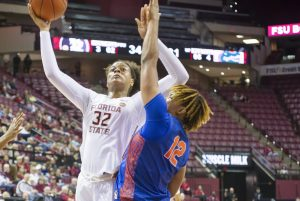 Valencia Myers powers up a shot against Florida. Mike Olivella photo.