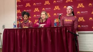 Kenisha Bell, Lindsay Whalen and Annalese Lamke address the media after their season-opening win Friday. Jared Hines photo.