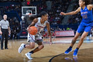 Crystal Dangerfield takes the ball inside the paint. Photo courtesy of UConn Athletics.