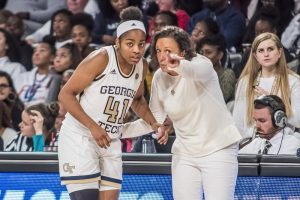 MaChelle Joseph gives instruction to Kierra Fletcher. Photo courtesy of Georgia Tech Athletics.