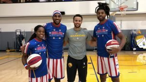 Lili Thompson with Zeus McClurkin, Steph Curry and Hammer Harrison. Photo courtesy of the Harlem Globetrotters.