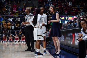 Coach Lindsay Gottlieb speaks to Asha Thomas and Kianna Smith during a game. Marcus Edwards/KLC fotos.