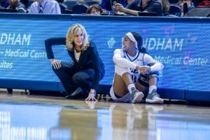 Coach Tina Langley has a word with Shani Rainey before sending her into the game. Photo by Juan DeLeon Studio/Rice Athletics.